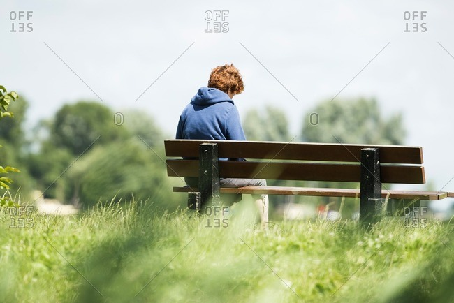 Middle-aged woman sitting on a bench in Leiden Zuid-Holland, Netherlands