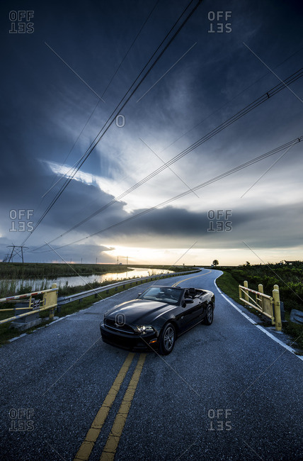 MIAMI, USA - JULY 12, 2016: Ford Mustang Convertible GT 2014 (fifth generation) version at Miami countryside roads, USA