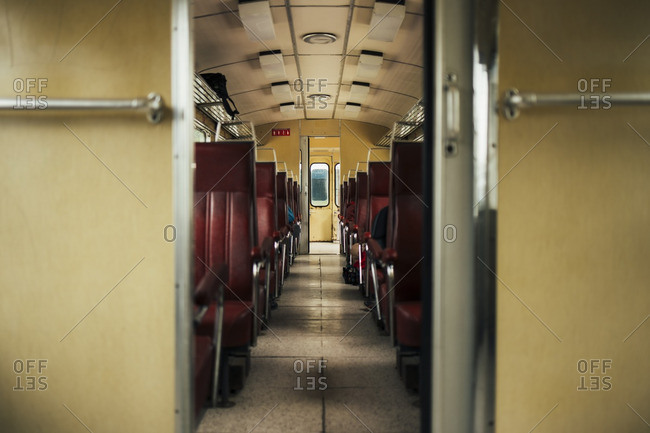 Person sitting in an empty train car
