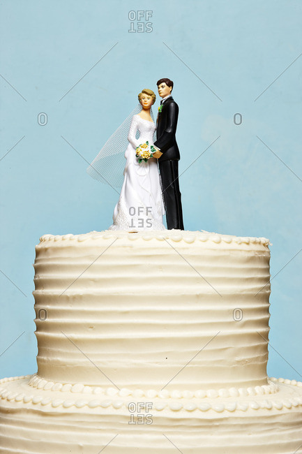 Wedding cake with traditional bride and groom topper