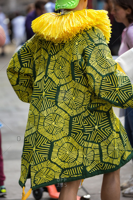 Model wearing bright yellow and black coat