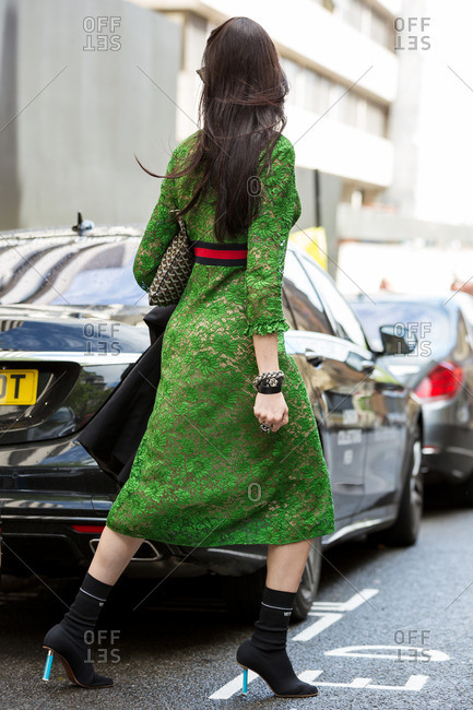 Woman crossing a London street in a green floral dress