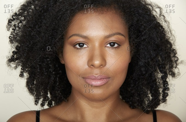 Close up of a woman with curly hair