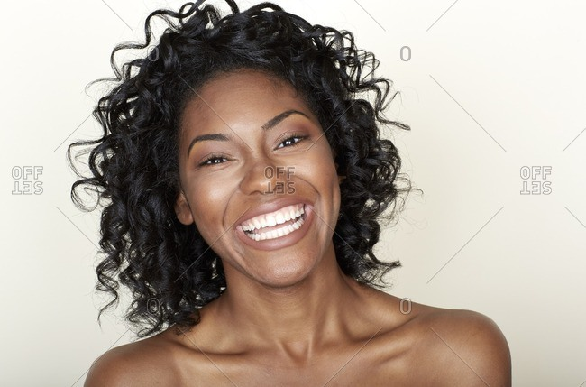 Close up of a smiling woman with curly hair