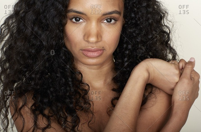 Close Up Of A Woman With A Beauty Mole And Curly Hair Stock