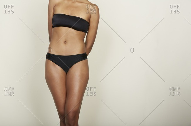 Woman's body wearing black strapless bra and panties