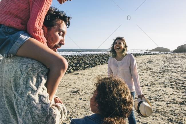 Playful family on beach in California