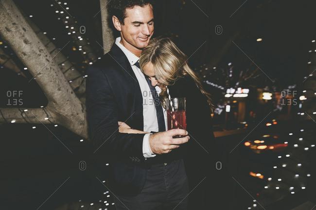 Woman hugging man at party