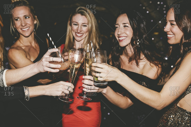 Female friends toasting at party