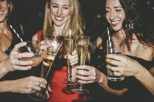 Female friends toasting at a party