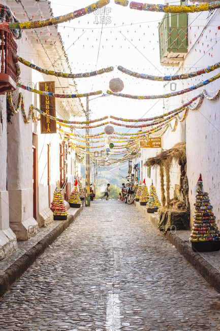 8/8/15: A narrow street with festive decorations in Santa Fe de Antioquia, Colombia