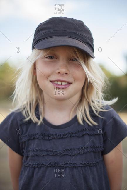 Sweden, Gotland, Faro, Smiling girl wearing baseball cap