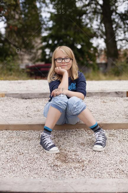 Sweden, Gotland, Bungenas, Portrait of smiling girl outdoors