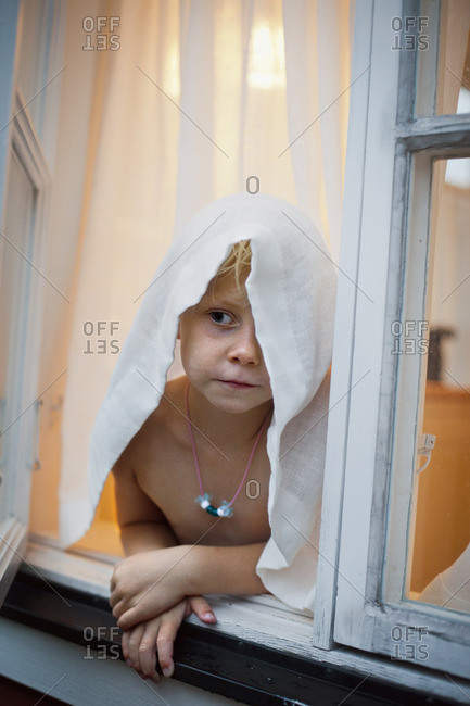 Sweden, Uppland, Moja, Shirtless girl leaning against window