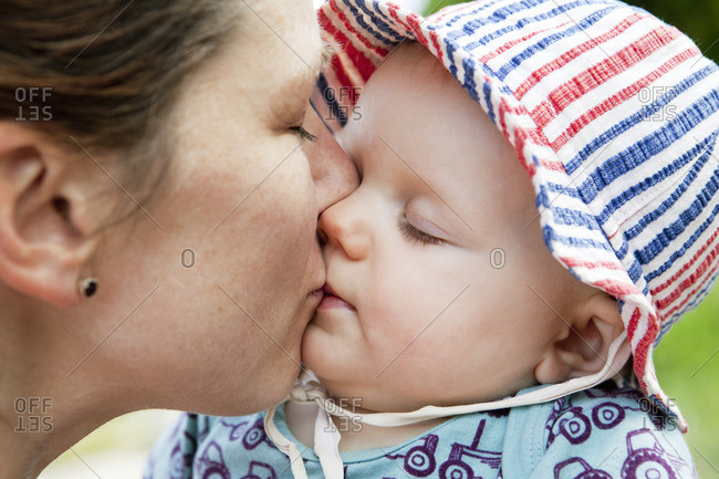 Sweden, Bohuslan, Woman kissing her baby daughter