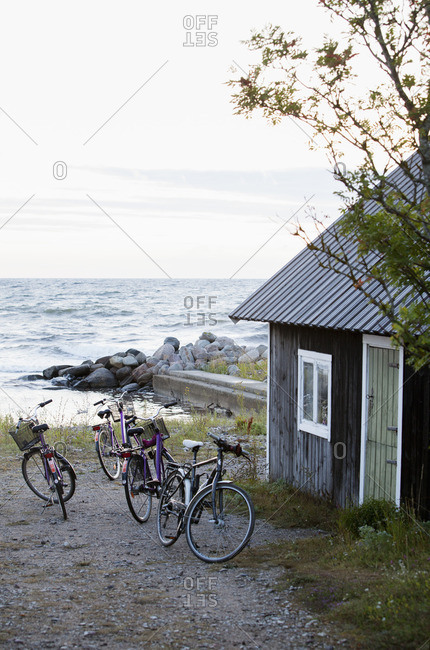 Sweden, Gotland, Bicycles near cottage at seaside