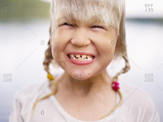 Sweden, Stockholm Archipelago, Uppland, Arholma, Portrait of girl smiling