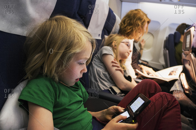 Sweden, Mother travelling by plane with children
