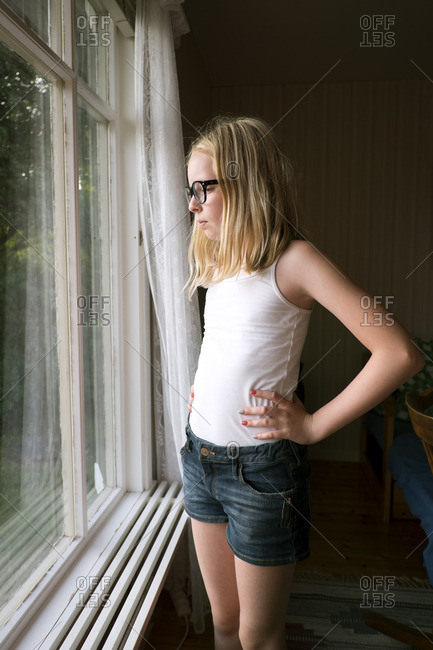 Sweden, Skane, Vejbystrand, Girl looking though window