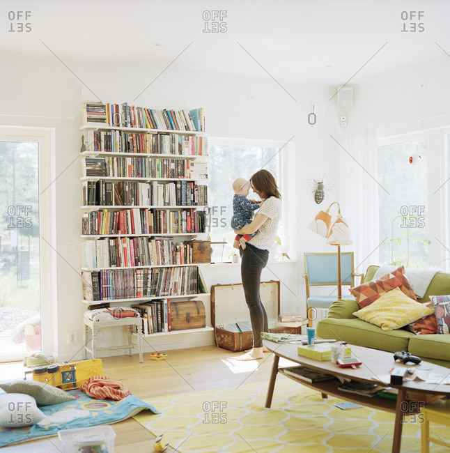 Sweden, Woman with her baby in domestic room