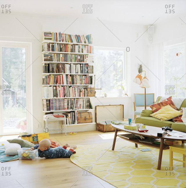 Sweden, Baby playing in domestic room