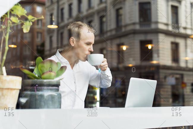 Sweden, Uppland, Stockholm, Man drinking tea