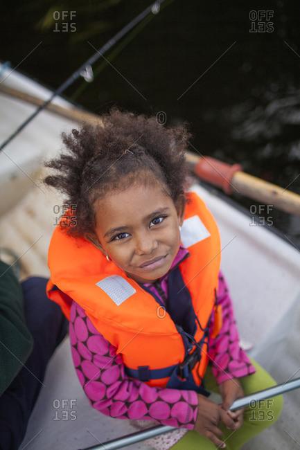 Sweden, Medelpad, Girl on boat