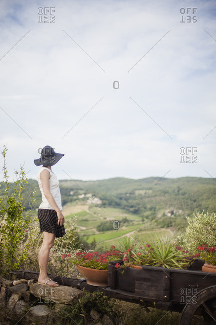 Italy, Tuscany, Woman in black hat looking at view