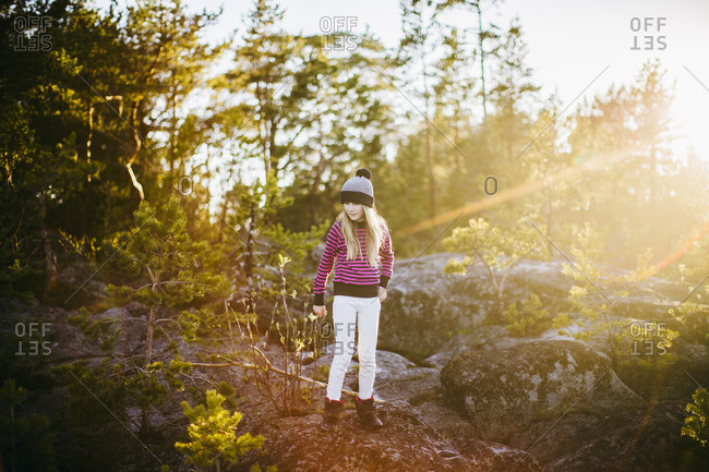 Sweden, Medelpad, Sundsvall, Juniskar, Portrait of girl standing in forest on sunny day