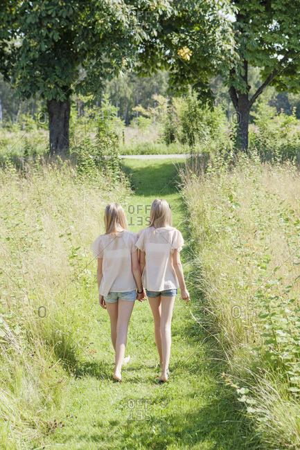 Sweden, Gotland, Eksta, View of two girls in footpath
