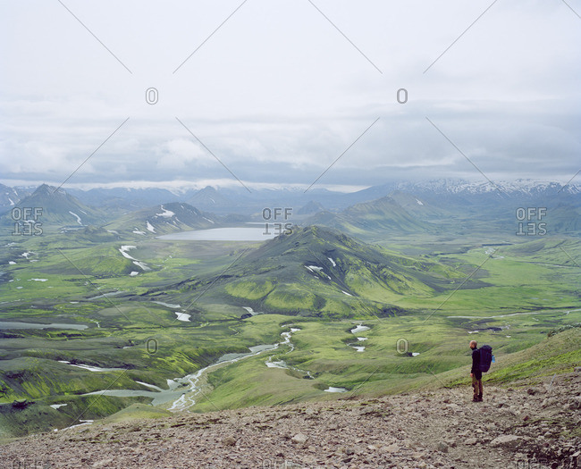 Iceland, Alftavatn Lake, Male tourist standing and looking at view
