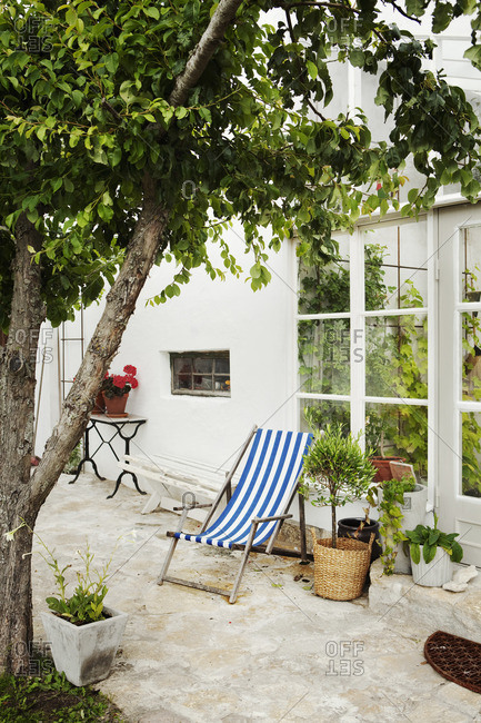 Sweden, Gotland, Bursvik, Burgegard, Sunlounger on patio