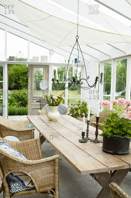 Sweden, Gotland, Bursvik, Burgegard, Wooden table and chairs in patio