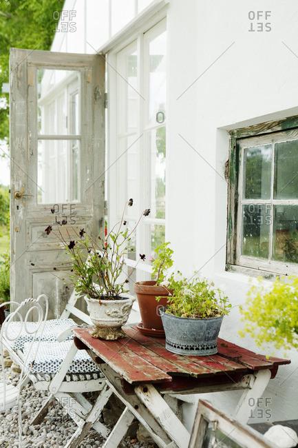 Sweden, Gotland, Bursvik, Burgegard, View of glass patio next to house