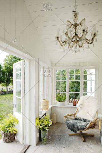 Sweden, Gotland, Bursvik, Burgegard, Wooden chair in patio