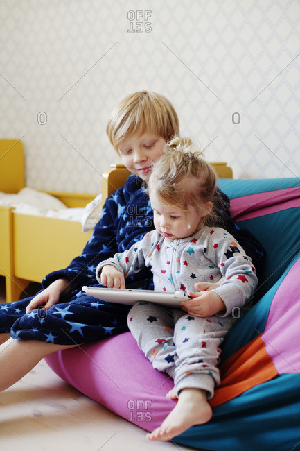 Sweden, Boy and girl using tablet