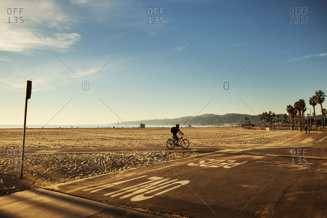 USA, California, Los Angeles, Venice Beach, One person cycling along beach