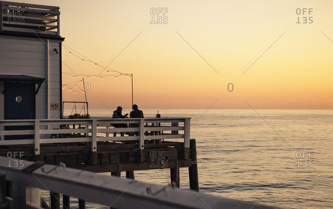 USA, California, Malibu, View of pier at sunset
