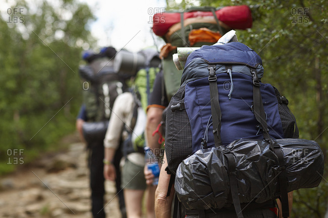 Sweden, Jamtland, People hiking with backpacks