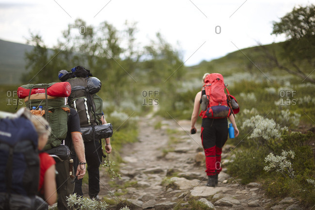 Sweden, Jamtland, People hiking with backpacks