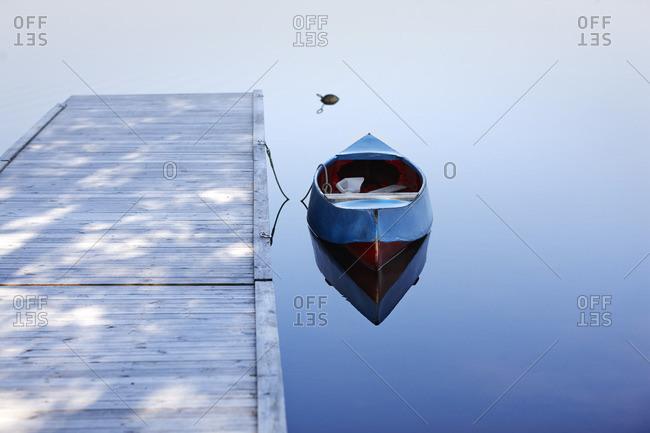 Sweden, Dalarna, Siljan, Kayak moored next to jetty