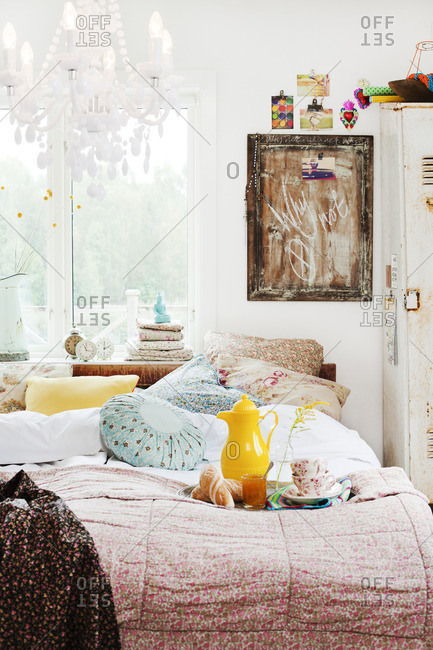 Sweden, View of bedroom with tray with breakfast