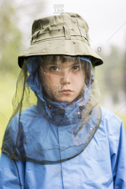 Sweden, Boy wearing hat with protective net