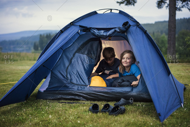 Sweden, Dalarna, Salen, Children in tent in meadow