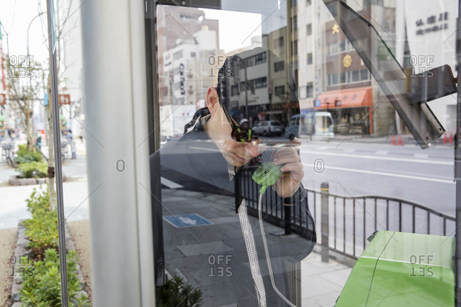Japan, Tokyo, Shibuya, Man talking on phone