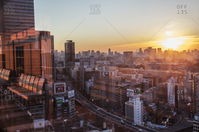 - November 28, 2015: Japan, Tokyo, Shibuya, View of city at sunset from window