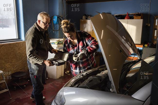 Sweden, Mechanics repairing car engine