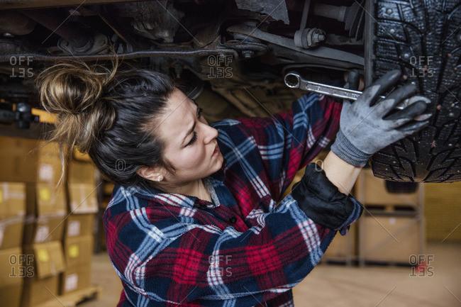 Sweden, Female mechanic adjusting wheel