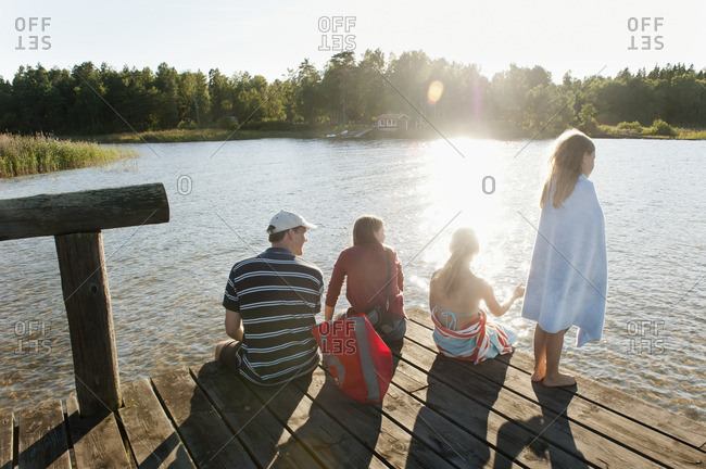 Sweden, Vastra Gotaland, Kallandso, Family with two children on pier