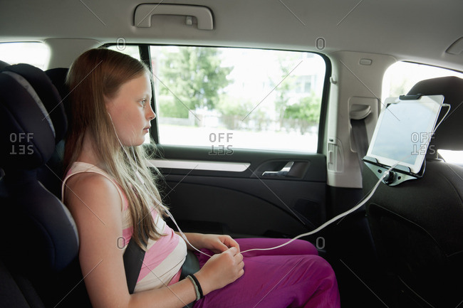 Austria, Girl watching movie in back seat